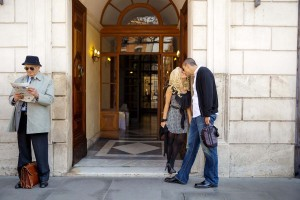 Romantically kissing at a door step in Rome during a photographer session