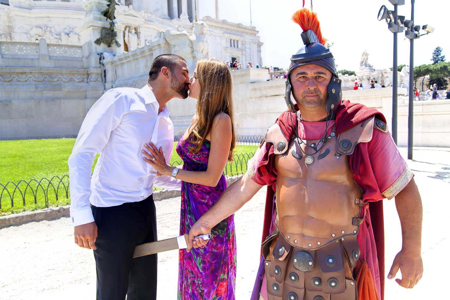 Funny picture of a couple during a photography session with a roman centurion