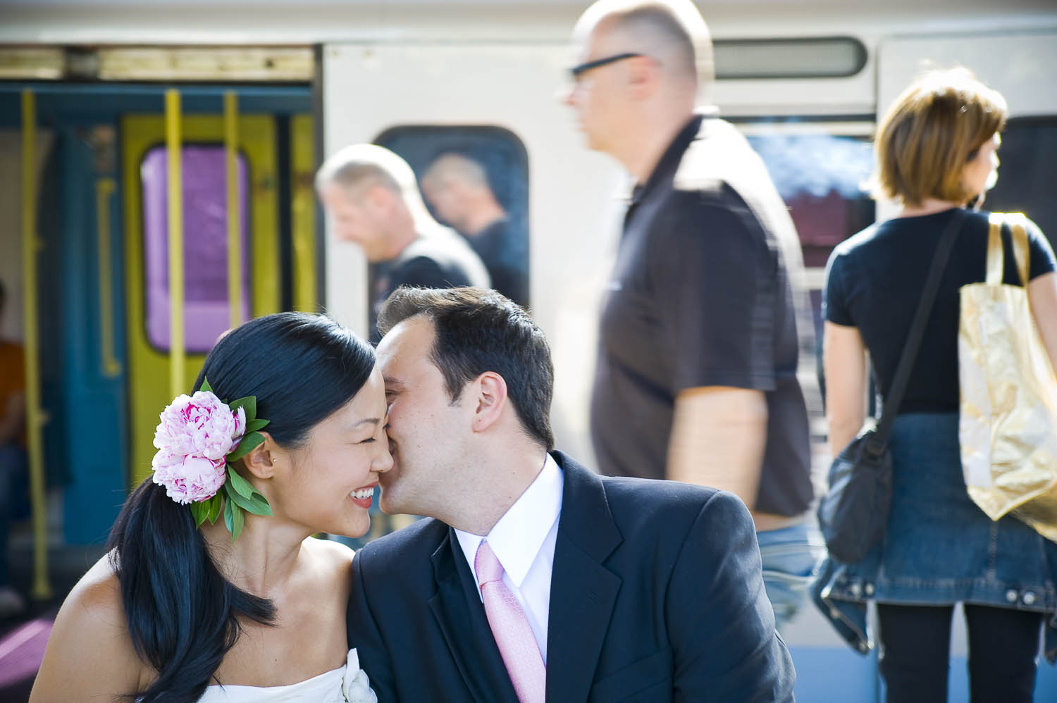Wedding couple kissing at a train station in Rome Italy during a photographer session