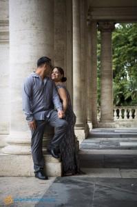 Romantic couple underneath the columns of Piazza del Campidolgio in Rome