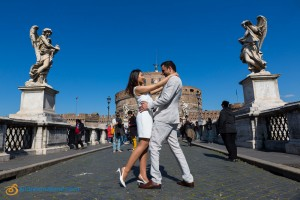 Pre Wedding Photographer in Rome. Photoshoot session taking place on bridge Castel Sant'Angelo in Rome