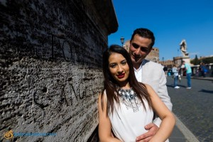 Couple posing during a prewedding photo shoot in Rome Italy: Ponte Castel Sant'Angelo