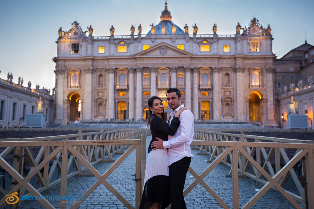 Portrait of a couple posing in front of Saint Peter's Basilica.