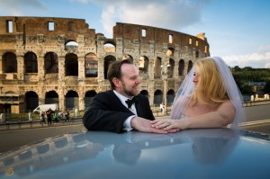 Wedding couple together in front of the Roman Colosseum.