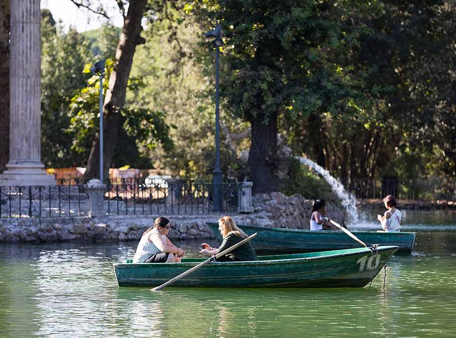 Asking the big question on a row boat on the Villa Borghese lake in Rome