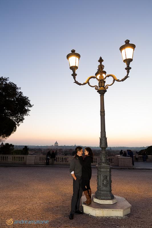 Engaged in Parco del Pincio in Villa Borghese.