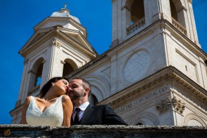 Close up picture of a wedding couple with blue sky above.