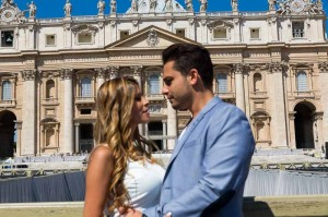 Picture taken of a couple in front of Saint Peter's Basilica in the Vatican Rome Italy