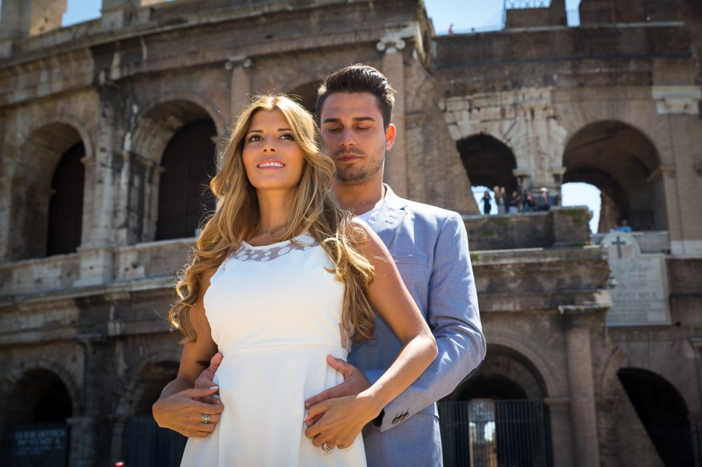 Couple photographed in front of the Roman Colosseum in Rome Italy