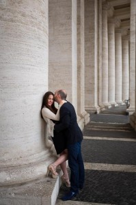 Couple in love under the columns of Saint Peter's square in the Vatican city