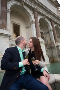 Engaged couple kissing at Gianicolo water fountain