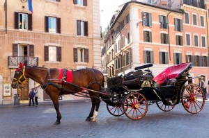 Horse pulled carriage in Rome Italy. Wedding photos ideas.