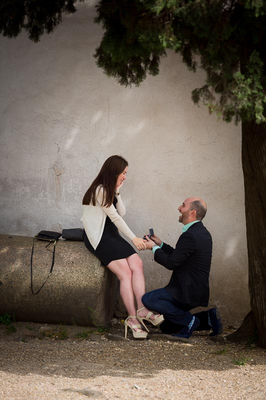 Man on one knee during the surprise proposal Rome Italy.