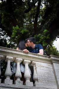 Couple kissing on a terrace