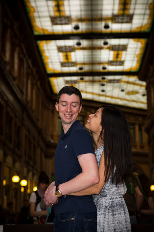 Interior shot of a couple in Galleria Alberto Sordi in Rome