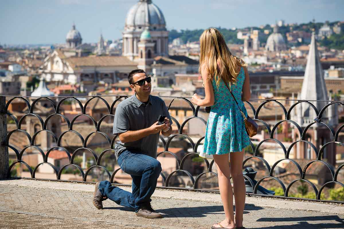 Knee down proposal photography Rome. Overlooking the roman rooftops.