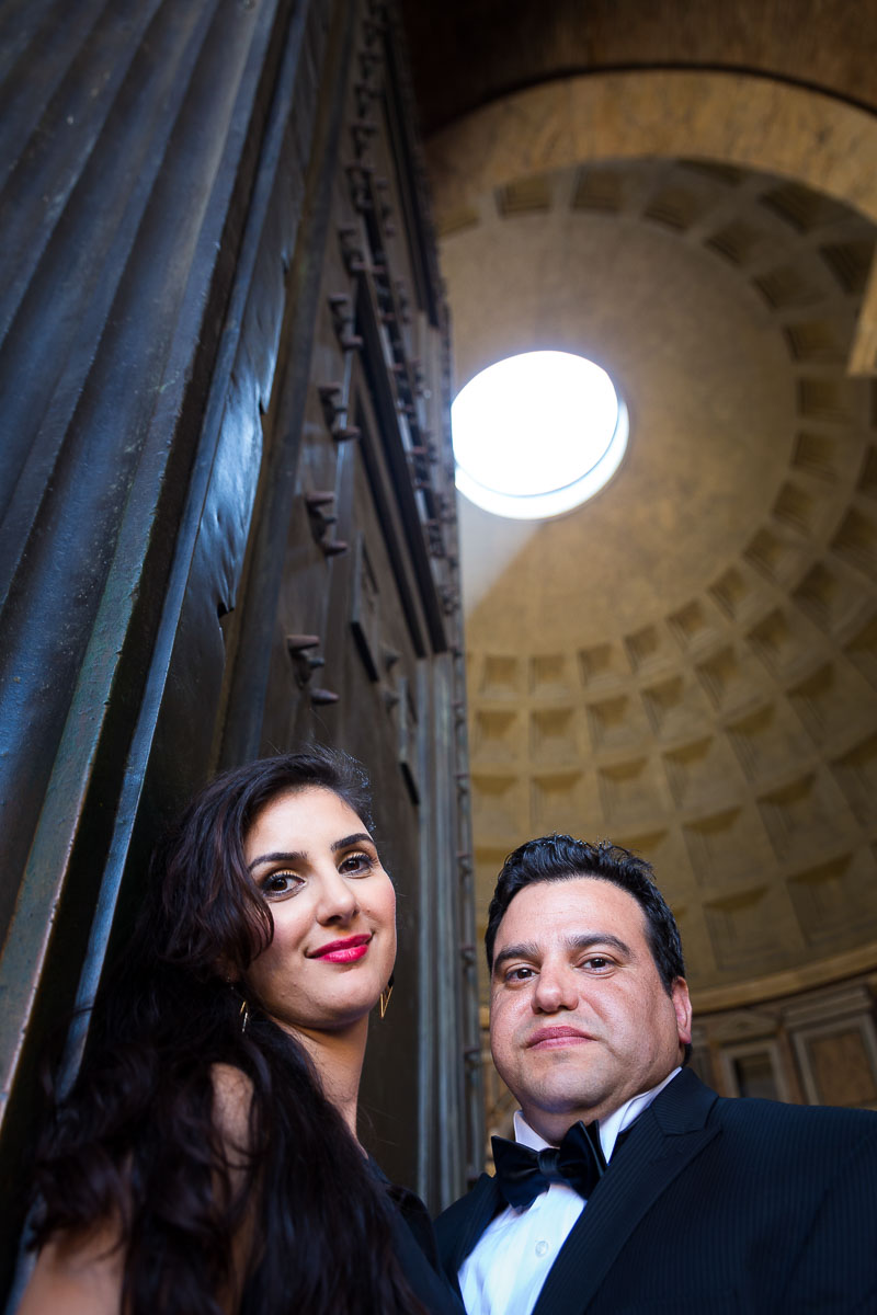 Couple underneath the light shining though the roof of the Pantheon