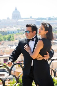 Couple together overlooking the rooftops in Rome Italy from Parco del Pincio