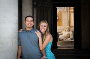 Posing for an engagement style portrait in Piazza del Campidoglio in Rome Italy