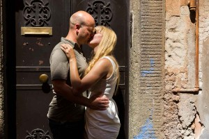 Kissing in the street of Trastevere in the old part of the city.