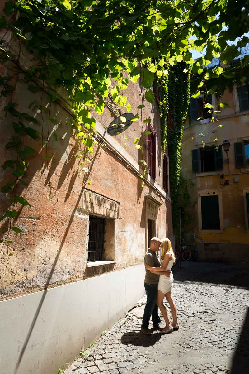 Embracing couple in the streets of Trastevere.