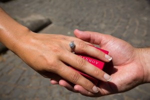 Couple holding a Danhov wedding ring.