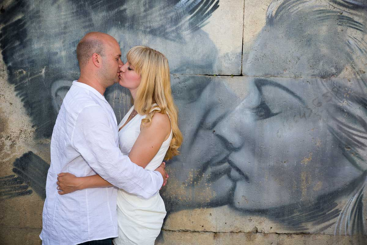 Kissing replicating a graffiti kiss.