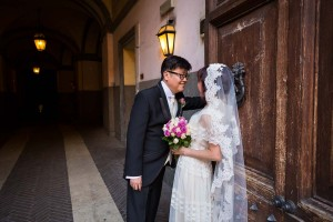 Wedding photo shoot in around the city by a characteristic wooden door