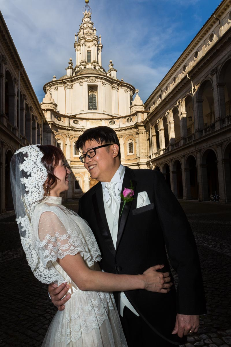 Image of newlyweds just married in Rome at San Ivo alla Sapienza