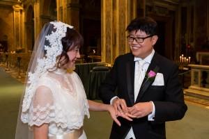 The wedding ring exchange during a Catholic matrimony