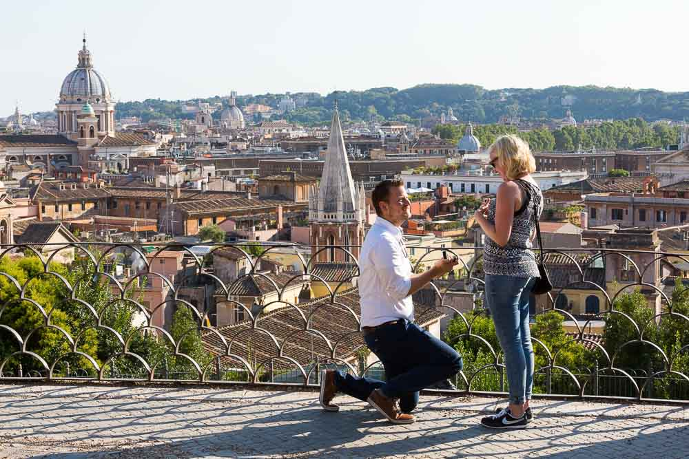 Surprise proposal taking place at Parco del Pincio overlooking the roman rooftops.