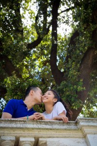 Kissing under a tree in Villa Borghese park.