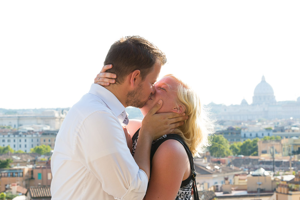 Couple just engaged kissing in Italy.