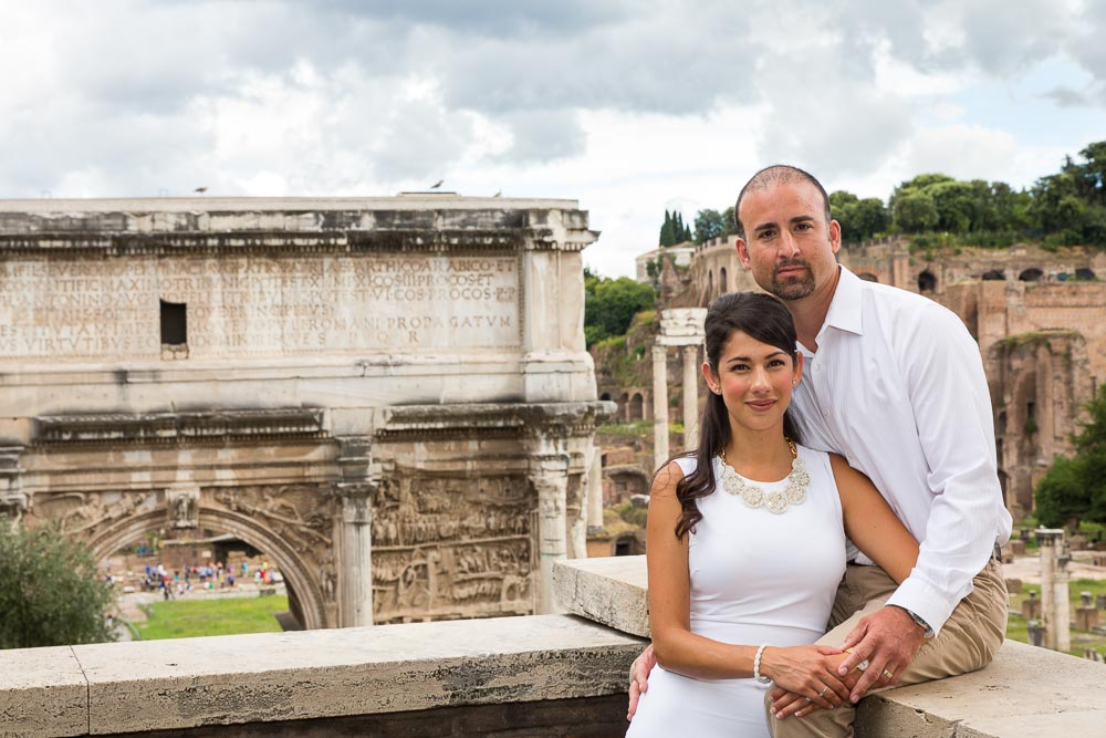 Portrait at the Forum with ancient monument in the back.