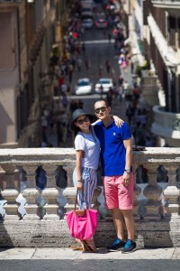 Posed picture of a couple at the Spanish steps overlooking Via Condotti.