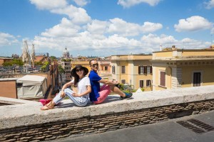 Sitting down before the sweeping view of the roman rooftops.