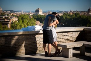 Couple hugging and embracing after a surprise proposal