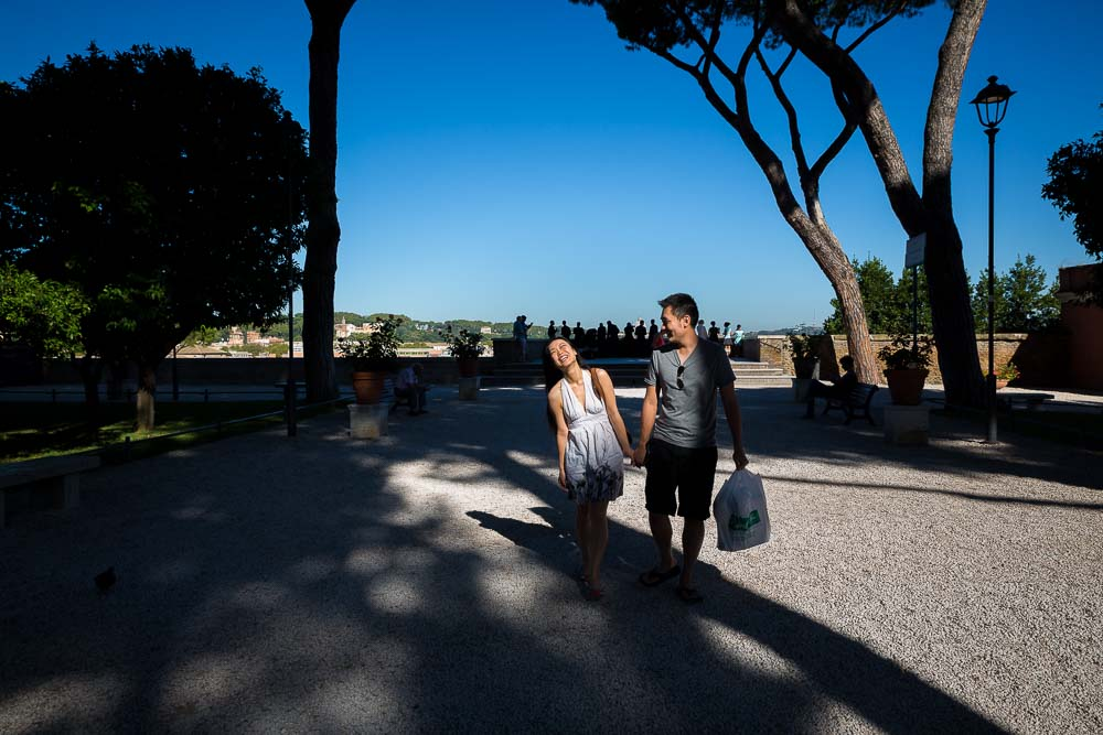 Walking away from Parco del Pincio together after a proposal