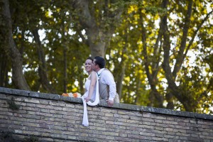 Just married couple photographed from below at the Gianiculum hill.