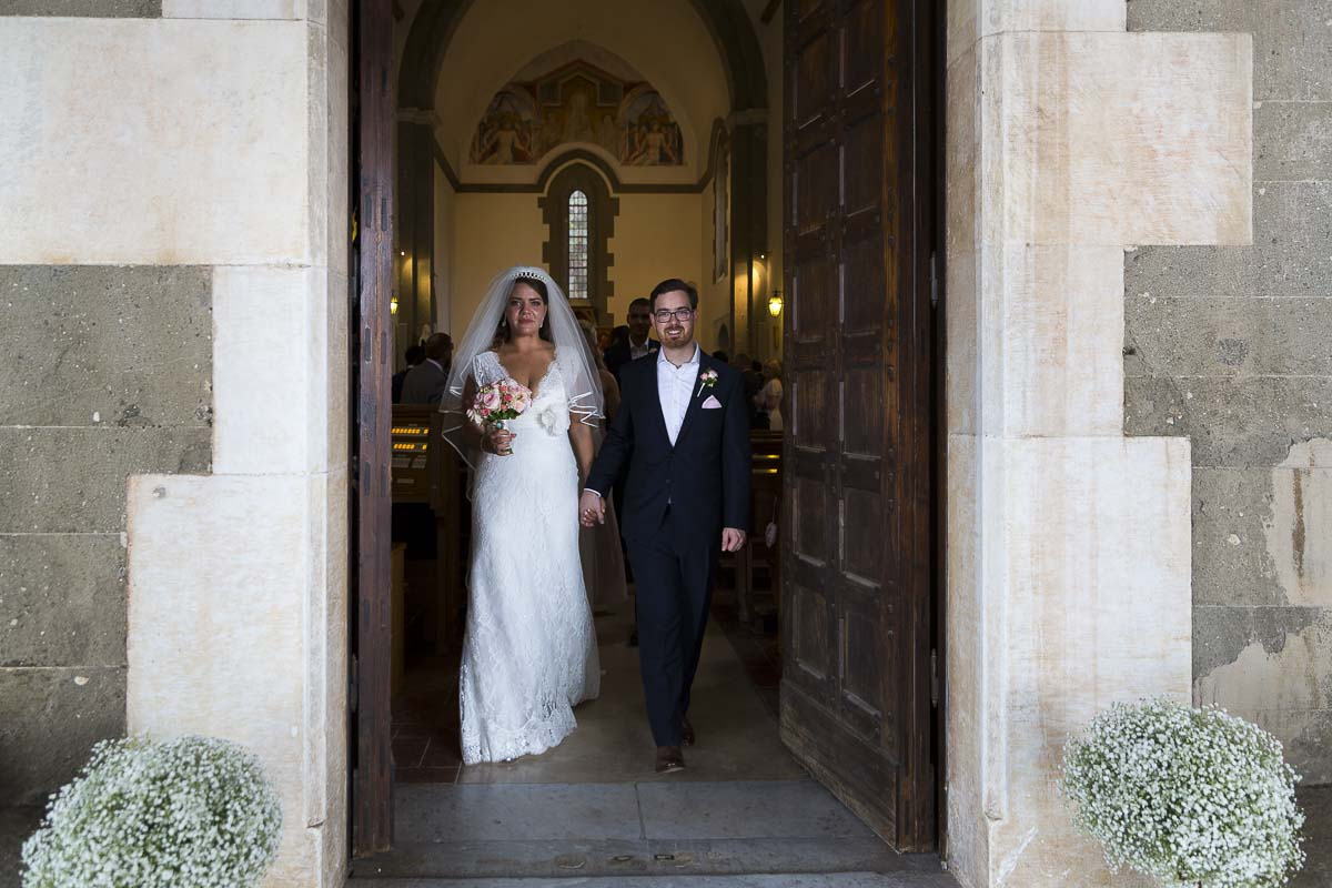 Newlywed exiting Villa Palazzola Church in Italy.