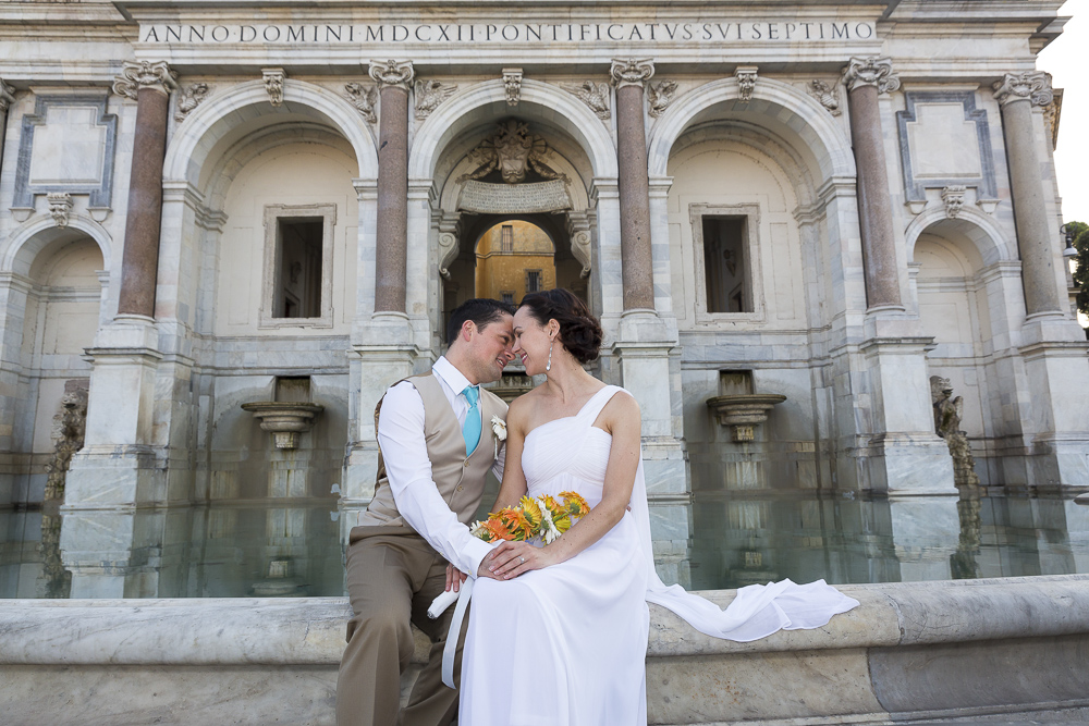 The gianicolo water fountain. Newlyweds posing for a picture.