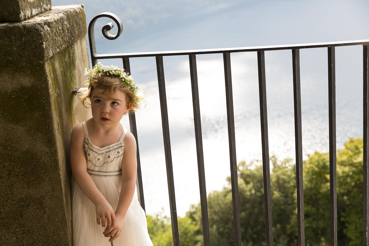 Flower girl portrait over the lake.