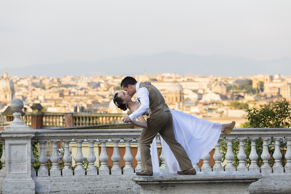 Couple just married dancing at the Gianciolo view of Rome Italy.