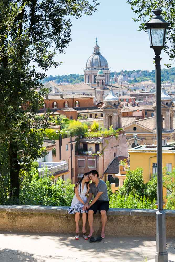 Man and woman together at Parco del Pincio overlooking the roman rooftop view.