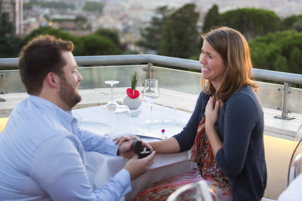 Surprise engagement proposal on a terrace view over Rome