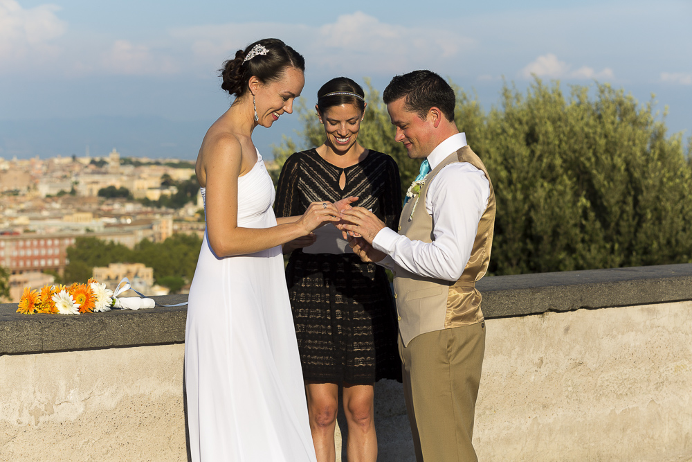 Exchanging wedding rings during a symbolic marriage.