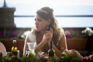Portrait picture of the bride sitting at the table.