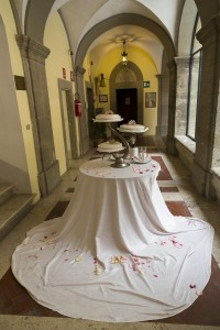 The wedding cake on the tables.