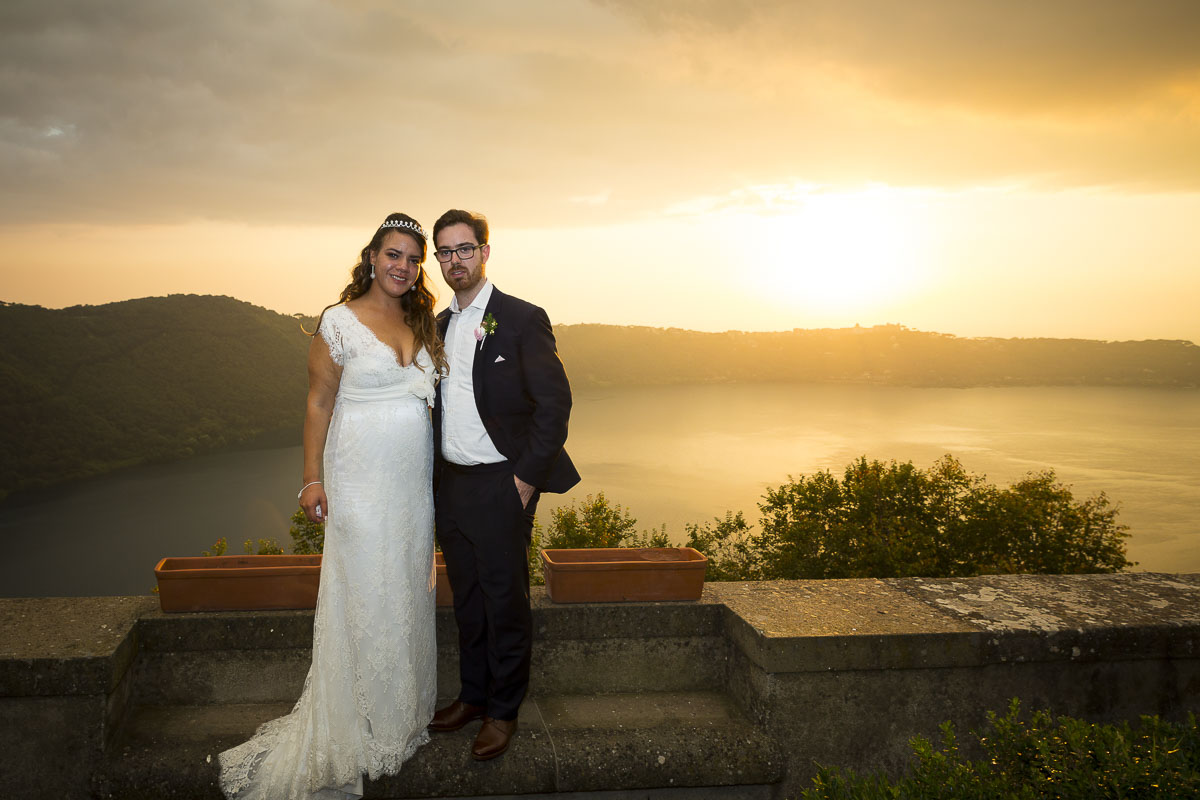 Bride and groom photographed over lake Castel Gandolfo.