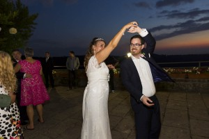 Groom and Bride dancing together.